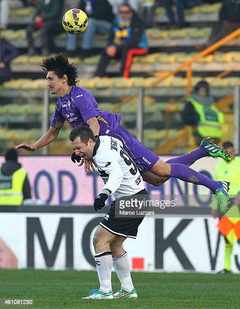 Antonio Cassano of Parma FC competes for the ball with Stefan Savic of ACF Fiorentina during the Serie A match between Parma FC and ACF Fiorentina at...