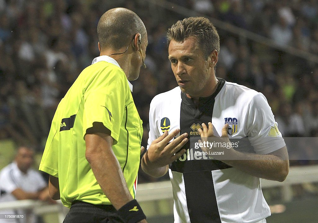 Antonio Cassano (R) of Parma FC disputes with referee Michael Fabbri (L) during the pre-season friendly match between Parma FC and Olympique de Marseille at Stadio Ennio Tardini on July 31, 2013 in Parma, Italy.