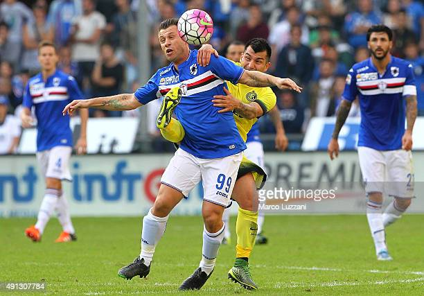 Antonio Cassano of UC Sampdoria competes for the ball with Gary Alexis Medel during the Serie A match between UC Sampdoria and FC Internazionale...