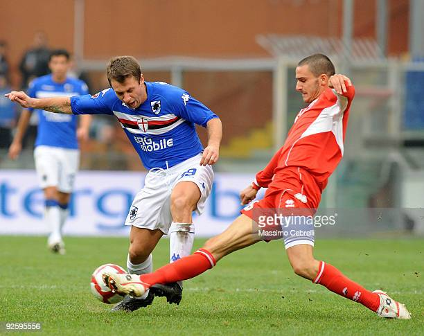 Antonio Cassano of UC Sampdoria is tackled by Leonardo Bonucci of AS Bari during the Serie A match between UC Sampdoria and AS Bari at Stadio Luigi...