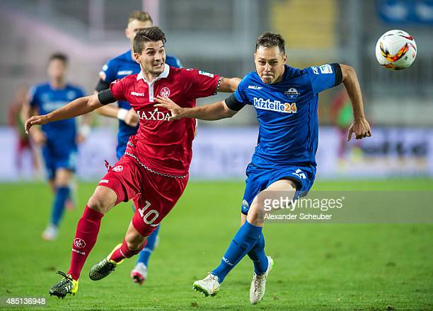 Antonio Colak of 1 FC Kaiserslautern challenges Florian Ruck of SC Paderborn during the second Bundesliga match between 1 FC Kaiserslautern and SC...