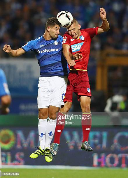 Antonio Colak of Darmstadt jumps for a header with Pavel Kaderabek of Hoffenheim during the Bundesliga match between SV Darmstadt 98 and TSG 1899...