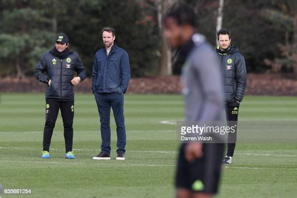 Antonio Conte and Carlo Cudicini of Chelsea with England manager Gareth Southgate during a training session at Chelsea Training Ground on February 16...
