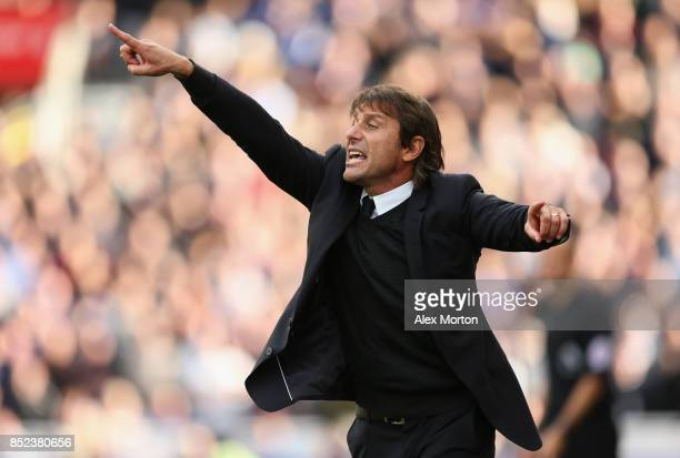 Antonio Conte gives instruction during the Premier League match between Stoke City and Chelsea at Bet365 Stadium on September 23 2017 in Stoke on...
