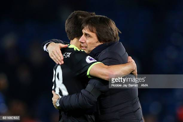 Antonio Conte head coach / manager of Chelsea celebrates with Cesar Azpilicueta of Chelsea at full time during the Premier League match between...