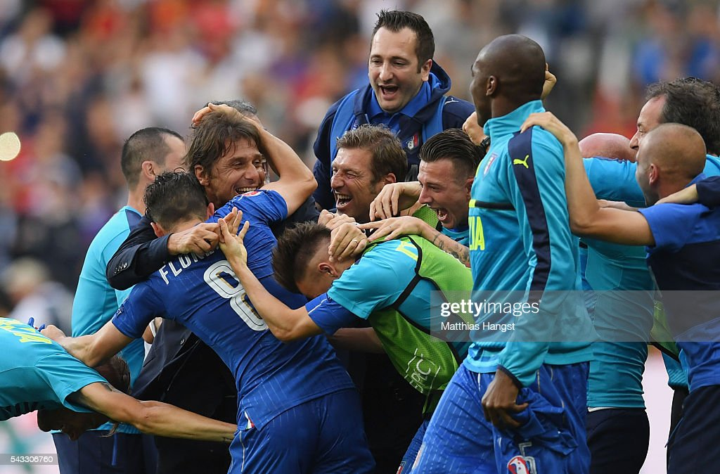 <a gi-track='captionPersonalityLinkClicked' href=/galleries/search?phrase=Antonio+Conte&family=editorial&specificpeople=2379002 ng-click='$event.stopPropagation()'>Antonio Conte</a> head coach of Italy celebrates his team's 2-0 win with his team players and staffs after the UEFA EURO 2016 round of 16 match between Italy and Spain at Stade de France on June 27, 2016 in Paris, France.