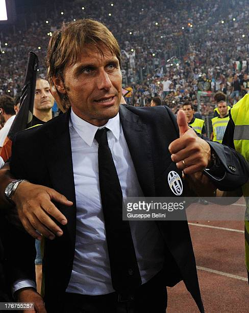 Antonio Conte head coach of Juventus celebrates the victory after the TIM Supercup match between SS Lazio and FC Juventus at Olimpico Stadium on...