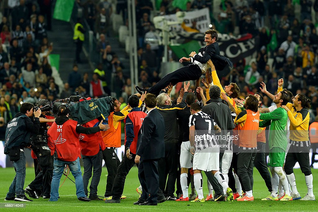 <a gi-track='captionPersonalityLinkClicked' href=/galleries/search?phrase=Antonio+Conte&family=editorial&specificpeople=2379002 ng-click='$event.stopPropagation()'>Antonio Conte</a> head coach of Juventus FC is lifted by his players after beating Atalanta BC 1-0 to win the Serie A Championships at the end of the Serie A match between Juventus and Atalanta BC at Juventus Arena on May 5, 2014 in Turin, Italy.