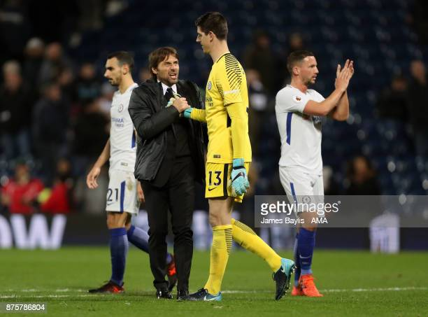 Antonio Conte manager / head coach of Chelsea and Chelsea goalkeeper Thibaut Courtois celebrate at full time after the Premier League match between...