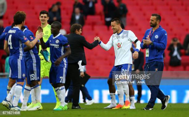 Antonio Conte manager / head coach of Chelsea celebrates with John Terry of Chelsea during the Emirates FA Cup semifinal match between Tottenham...
