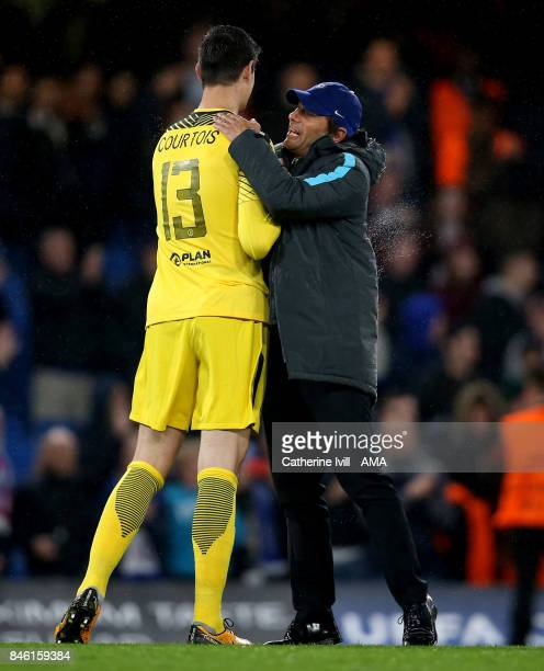 Antonio Conte manager / head coach of Chelsea congratulates Chelsea goalkeeper Thibaut Courtois after the UEFA Champions League group C match between...