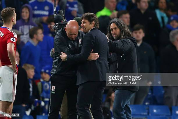Antonio Conte manager / head coach of Chelsea consoles Steve Agnew caretaker manager of Middlesbrough after the Premier League match between Chelsea...