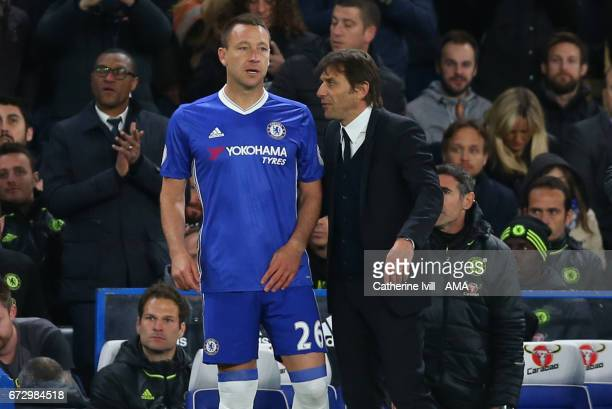 Antonio Conte manager / head coach of Chelsea talks to John Terry of Chelsea as he waits to come on as substitute during the Premier League match...
