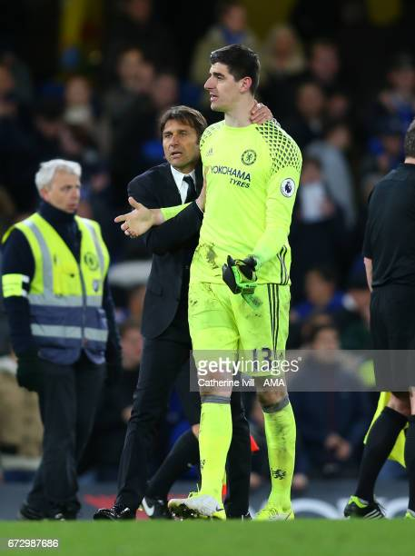 Antonio Conte manager / head coach of Chelsea with Thibaut Courtois of Chelsea after the Premier League match between Chelsea and Southampton at...