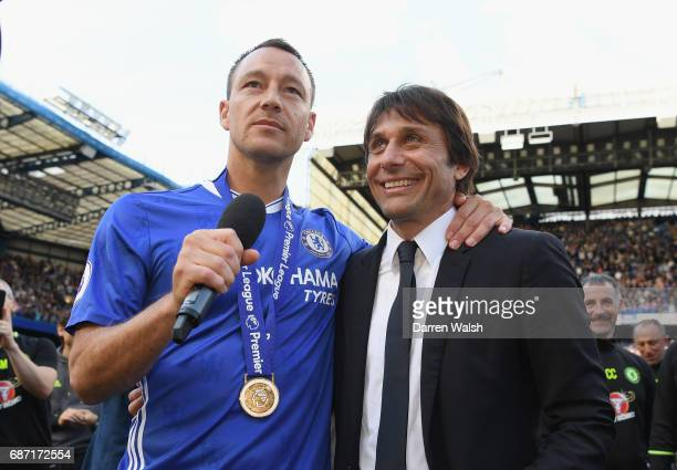 Antonio Conte Manager of Chelsea anch John Terry of Chelsea celebrate winning the league following the Premier League match between Chelsea and...