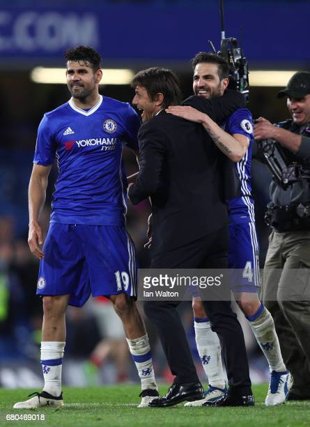 Antonio Conte Manager of Chelsea and Cesc Fabregas of Chelsea celebrate after the full time whistle in the Premier League match between Chelsea and...