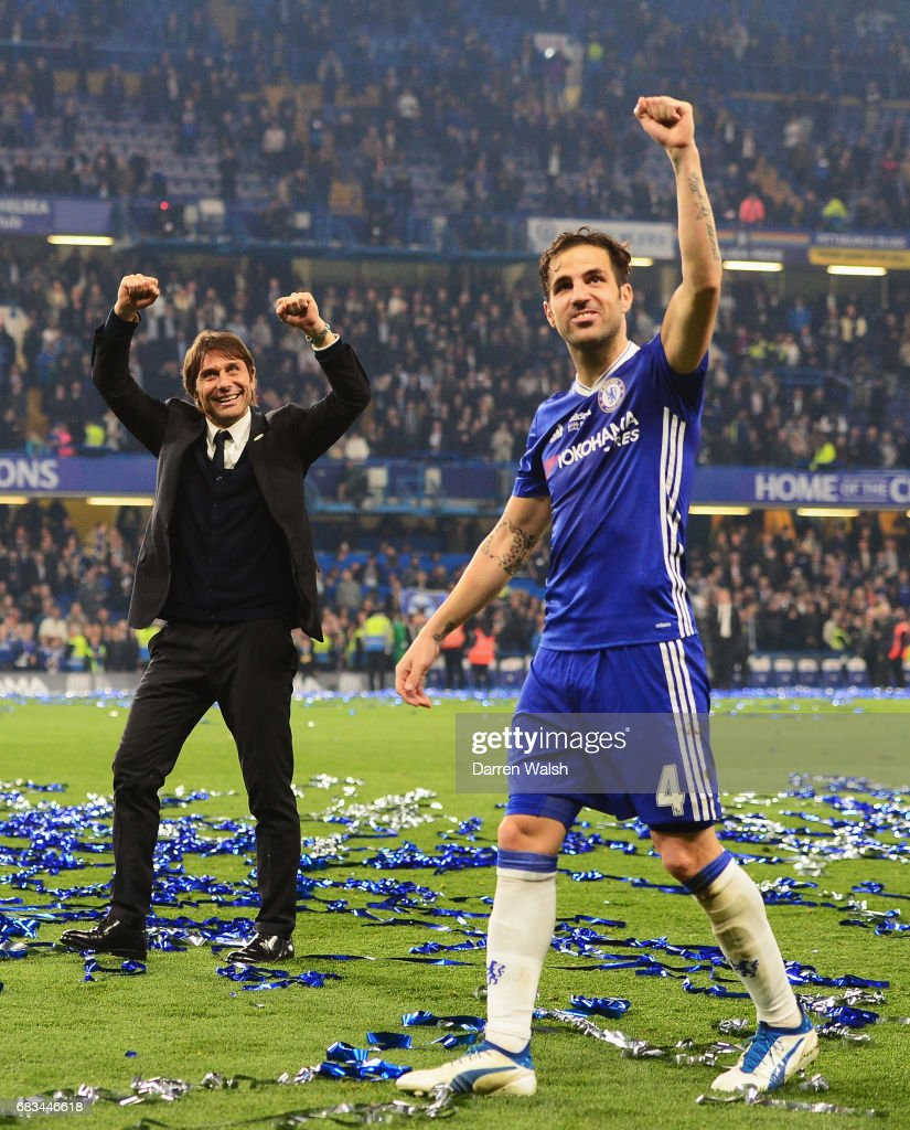 Antonio Conte, Manager of Chelsea and Cesc Fabregas of Chelsea celebrate after the Premier League match between Chelsea and Watford at Stamford Bridge on May 15, 2017 in London, England.