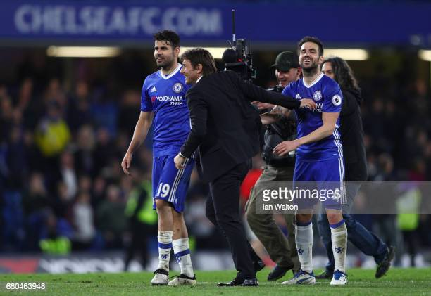 Antonio Conte Manager of Chelsea and Cesc Fabregas of Chelsea celebrate during the Premier League match between Chelsea and Middlesbrough at Stamford...