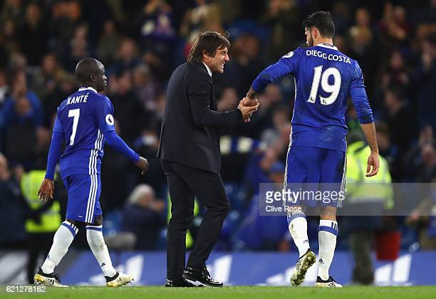 Antonio Conte Manager of Chelsea and Diego Costa of Chelsea celebrate after the final whislte during the Premier League match between Chelsea and...