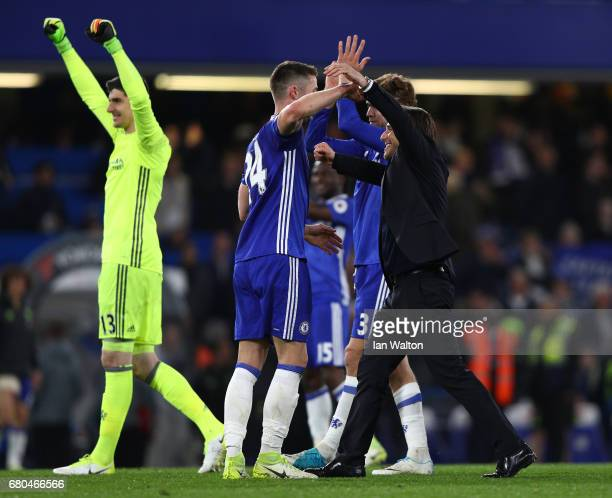 Antonio Conte Manager of Chelsea and Gary Cahill of Chelsea celebrate following the Premier League match between Chelsea and Middlesbrough at...