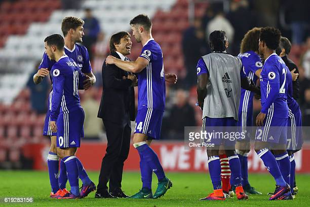 Antonio Conte Manager of Chelsea and Gary Cahill of Chelsea embrace after the final whistle during the Premier League match between Southampton and...