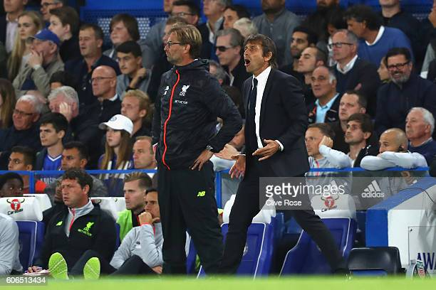 Antonio Conte Manager of Chelsea and Jurgen Klopp Manager of Liverpool look on from the touchline during the Premier League match between Chelsea and...