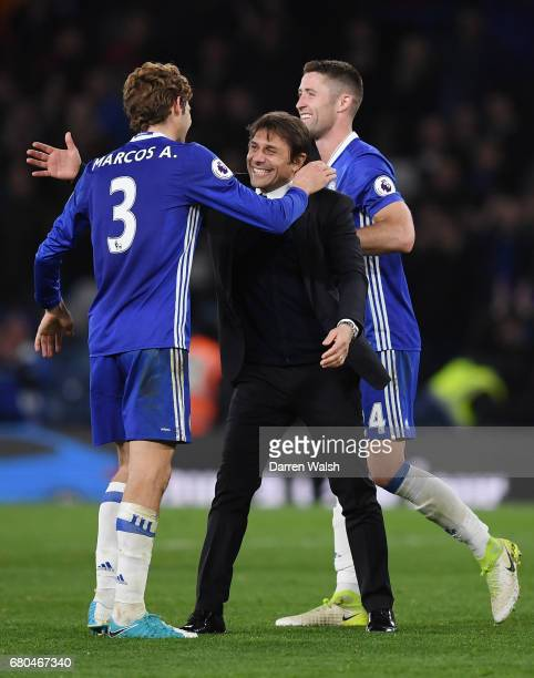 Antonio Conte Manager of Chelsea and Marcos Alonso of Chelsea celebrate following the Premier League match between Chelsea and Middlesbrough at...