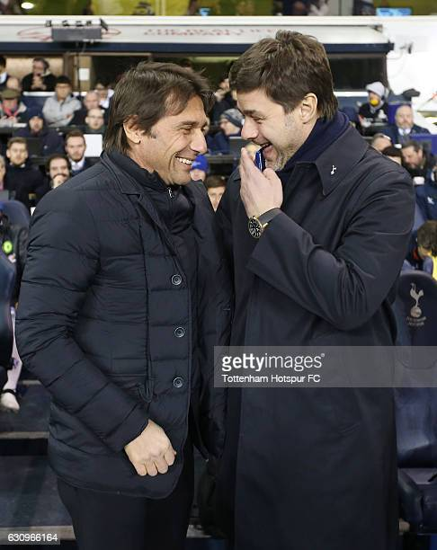 Antonio Conte Manager of Chelsea and Mauricio Pochettino Manager of Tottenham Hotspur embrace prior to the Premier League match between Tottenham...