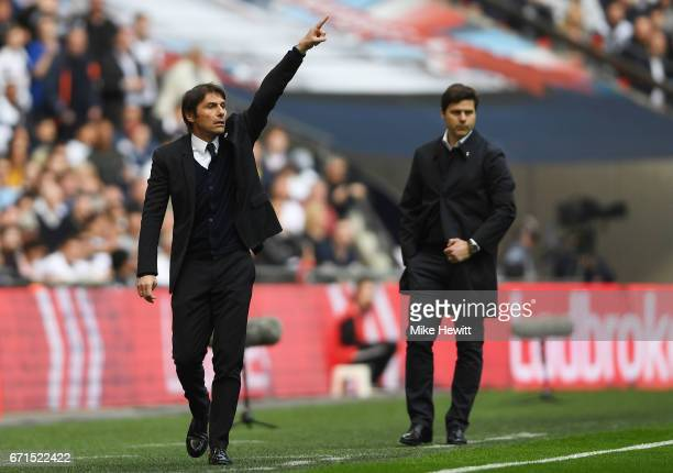 Antonio Conte Manager of Chelsea and Mauricio Pochettino Manager of Tottenham Hotspur look on during The Emirates FA Cup SemiFinal between Chelsea...