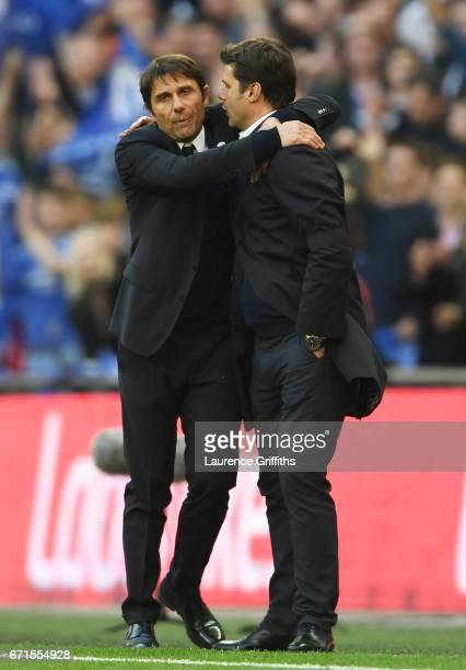 Antonio Conte Manager of Chelsea and Mauricio Pochettino Manager of Tottenham Hotspur shake hands after the full time whistle during The Emirates FA...