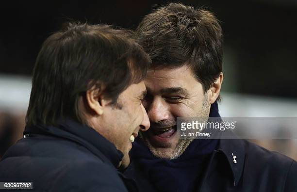 Antonio Conte Manager of Chelsea and Mauriio Pochettino Manager of Tottenham Hotspur speak prior to the Premier League match between Tottenham...