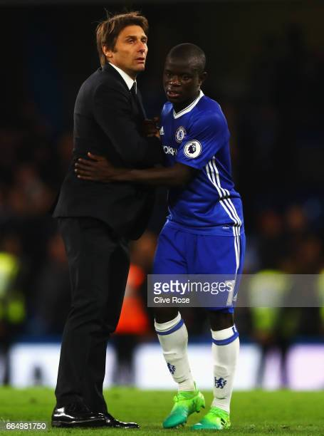 Antonio Conte Manager of Chelsea and N'Golo Kante of Chelsea embrace after the Premier League match between Chelsea and Manchester City at Stamford...