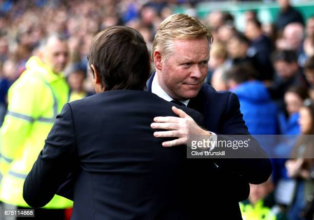 Antonio Conte Manager of Chelsea and Ronald Koeman Manager of Everton embrace prior to the Premier League match between Everton and Chelsea at...