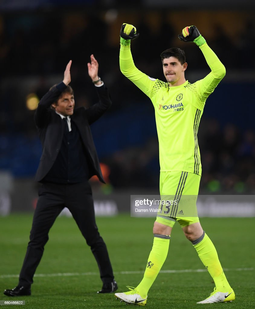 Antonio Conte, Manager of Chelsea and Thibaut Courtois of Chelsea celebrate after the Premier League match between Chelsea and Middlesbrough at Stamford Bridge on May 8, 2017 in London, England.