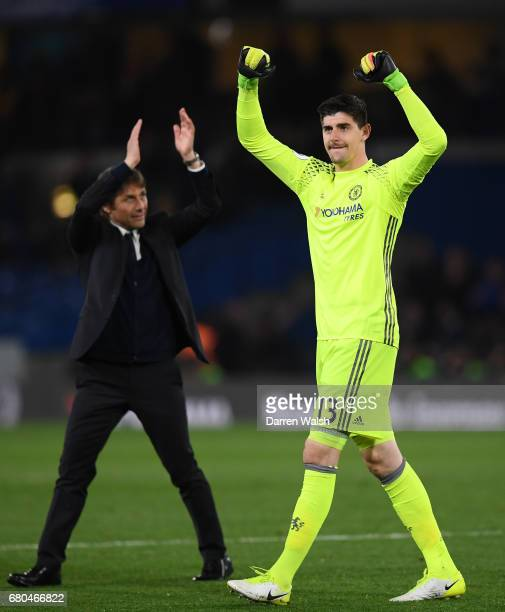 Antonio Conte Manager of Chelsea and Thibaut Courtois of Chelsea celebrate after the Premier League match between Chelsea and Middlesbrough at...