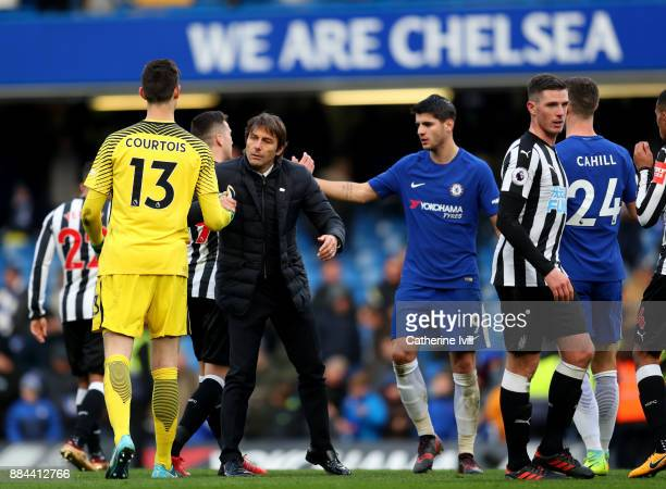 Antonio Conte Manager of Chelsea and Thibaut Courtois of Chelsea celebrates victory after the Premier League match between Chelsea and Newcastle...