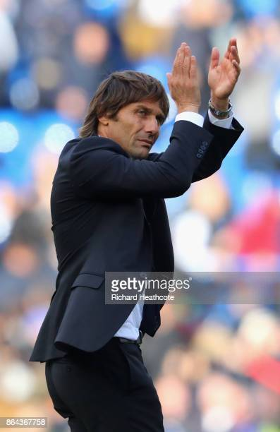 Antonio Conte Manager of Chelsea aplauds the home fans after the Premier League match between Chelsea and Watford at Stamford Bridge on October 21...
