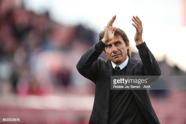 Antonio Conte manager of Chelsea applauds the fans at full time during the Premier League match between Stoke City and Chelsea at Bet365 Stadium on...