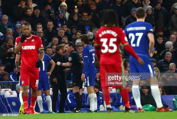 Antonio Conte Manager of Chelsea argues with referee Neil Swarbrick during the Premier League match between Chelsea and Swansea City at Stamford...
