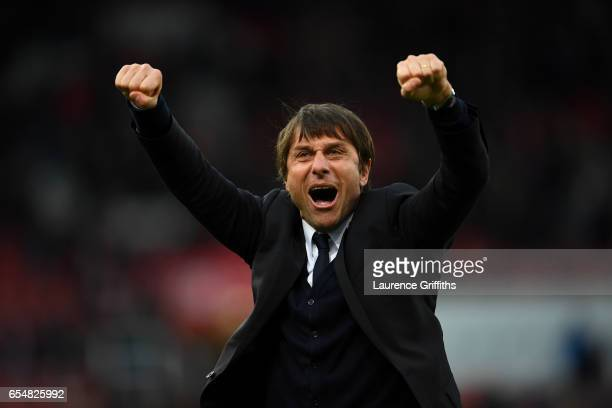 Antonio Conte Manager of Chelsea celebrates after the Premier League match between Stoke City and Chelsea at Bet365 Stadium on March 18 2017 in Stoke...