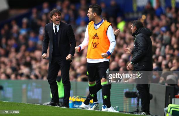 Antonio Conte Manager of Chelsea celebrates his sides first goal during the Premier League match between Everton and Chelsea at Goodison Park on...