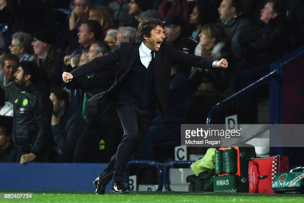 Antonio Conte Manager of Chelsea celebrates his sides first goal during the Premier League match between West Bromwich Albion and Chelsea at The...