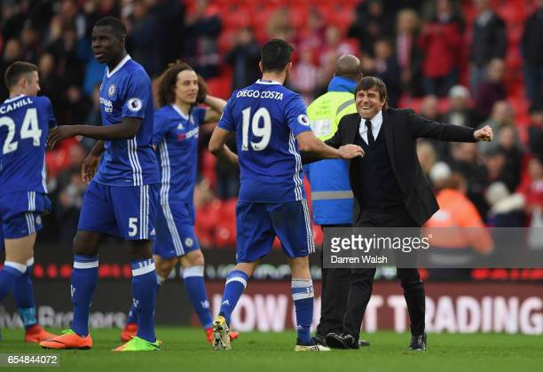 Antonio Conte manager of Chelsea celebrates victory with Diego Costa of Chelsea after the Premier League match between Stoke City and Chelsea at...