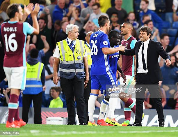 Antonio Conte Manager of Chelsea celebrates victory with John Terry of Chelsea after the Premier League match between Chelsea and West Ham United at...