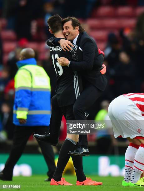 Antonio Conte Manager of Chelsea celebrates winning at the end of the match with Thibaut Courtois of Chelsea during the Premier League match between...