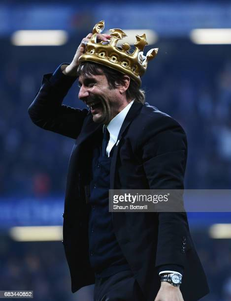 Antonio Conte Manager of Chelsea celebrates with a inflatable crown after the Premier League match between Chelsea and Watford at Stamford Bridge on...
