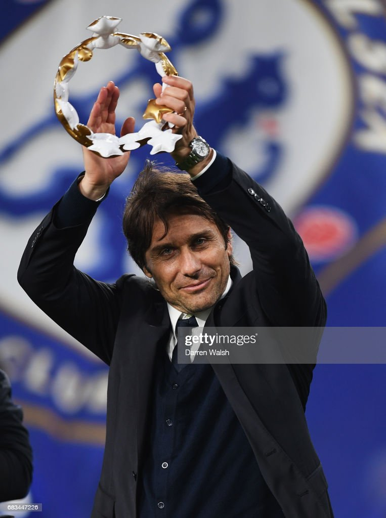 Antonio Conte, Manager of Chelsea celebrates with a inflatable crown after the Premier League match between Chelsea and Watford at Stamford Bridge on May 15, 2017 in London, England.