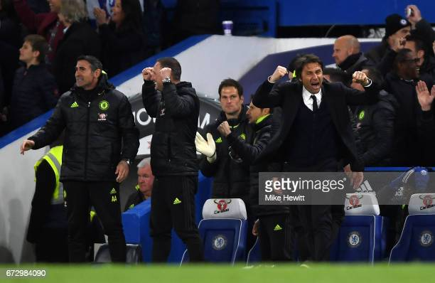 Antonio Conte manager of Chelsea celebrates with the team bench during the Premier League match between Chelsea and Southampton at Stamford Bridge on...