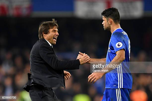 Antonio Conte Manager of Chelsea congratulates Diego Costa after their team's 21 win in the Premier League match between Chelsea and Tottenham...