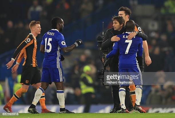 Antonio Conte Manager of Chelsea congratulates N'Golo Kante and Victor Moses at the final whistle of the Premier League match between Chelsea and...
